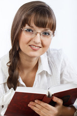 Beautiful Smiling girl reading a book