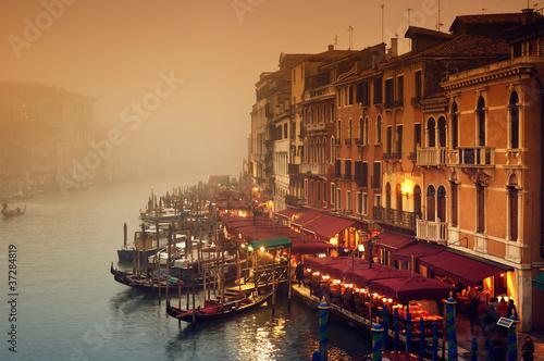 Leinwanddruck Bild Grand Canal at a foggy evening.