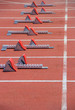 Athletics Starting Blocks on a red running track in the stadium