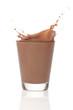 Leinwandbild Motiv Milk chocolate splah over white background