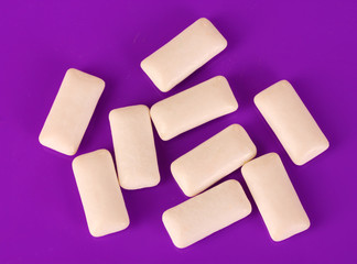 Chewing gums on purple background