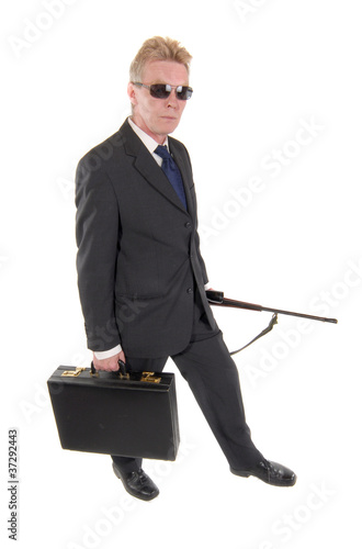 Assassin or spy with a briefcase and rifle