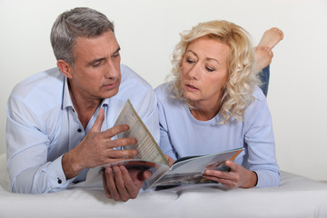 Couple looking at a catalogue