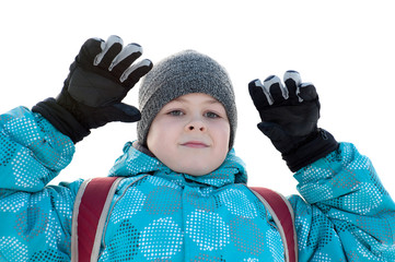 A boy in winter clothes and a backpack on a white background