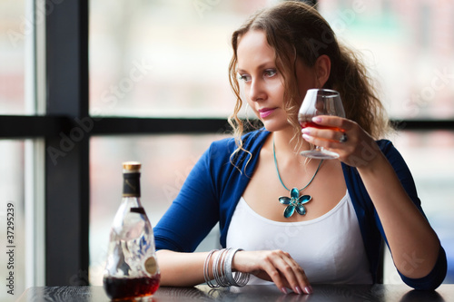 Young woman with a cognac