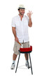 Man stood cooking on barbecue