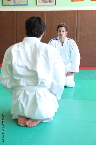Men at the start of a judo match