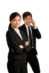 Asian Business woman with colleague in background