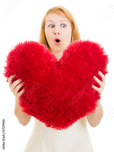 Surprised girl with a heart on a white background.