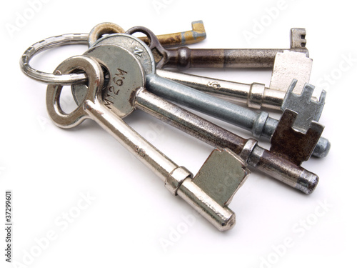 Set of keys on a ring on a white background