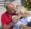 senior couple kissing tenderly