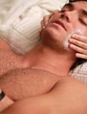 Close up of massage to a relaxed young man