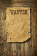 Wild West wanted poster on old wooden wall