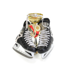 Hockey skates and cup winner