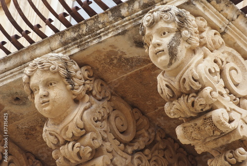 ornamental angels of balcony, Noto, Sicily