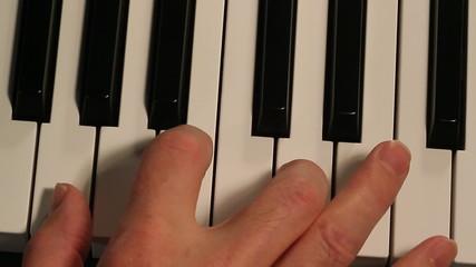 Piano player exterme closeup