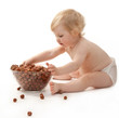 The baby girl with hazelnuts