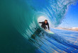 Surfer on Blue Ocean Wave in the Tube
