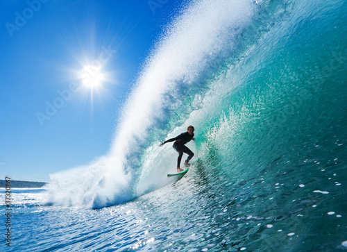 canvas print picture Surfer on Blue Ocean Wave