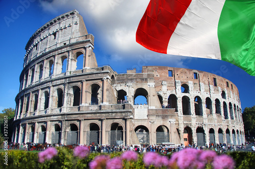 Colosseum with flag of Italy , Rome