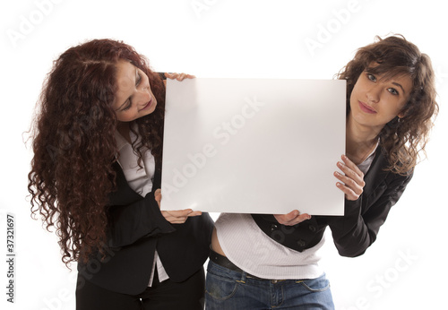 Young women holding billboard
