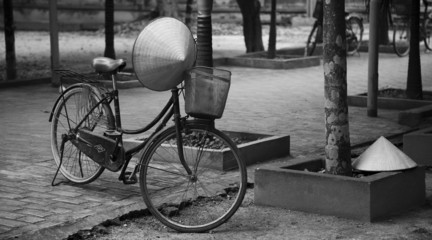 Vietnamese hat hanging on a bike