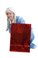 girl in christmas costume of Snow Maiden with  a gift packet