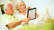 Senior Couple at Home with a Wireless Tablet