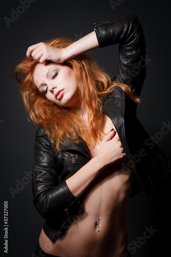 Portrait of a beautiful young redhead woman
