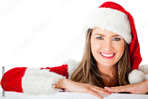 Mrs Claus leaning on a banner