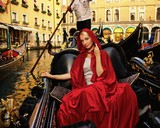 Beautifiul woman in red cloak riding on gandola poster