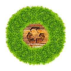 recycle sign and green grass on wood background