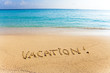 "Inscription on sand ""vacation"""