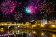 fireworks over bridge Vittorio Emmanuel through Tiber.Italy.Rome