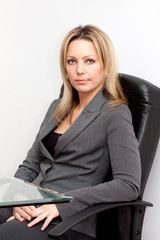 Confident business woman in black chair