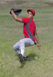 Baseball player winds up for a strong throw