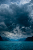 Fototapety Fjord with dark clouds