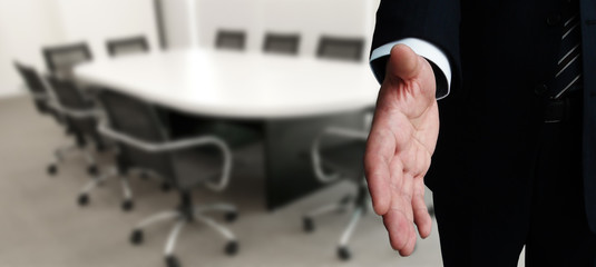Business man stretching hand for a shake