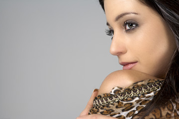 Young woman in animal print shirt