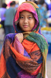 girl and colorful silk clothes cover her head