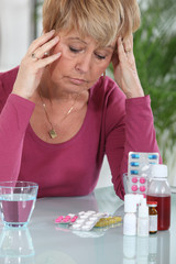 Woman sat in front of medication