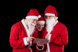 Three santa claus