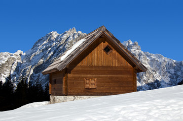 Mountain chalet in winter - Italy Alps