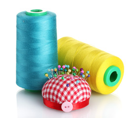 Bobbins of thread with colored pinheads in pin-cushion isolated