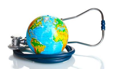 Globe and stethoscope isolated on white.