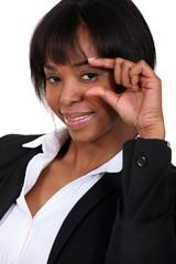 African American woman gesturing smallness.