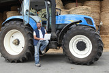 Farmer using a laptop on his tractor