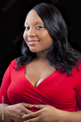 Plus-size Black Pregnant Woman in Red Dress