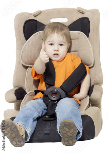 The little boy sits in an automobile armchair by jura, Royalty ...