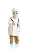 Adorable boy uniformed as doctor over white background